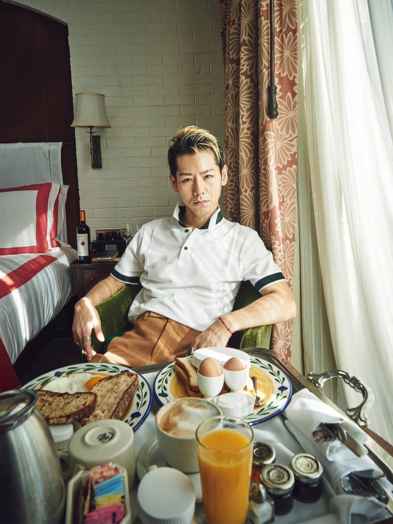 Takeru Kobiyashi reclines in his hotel room with breakfast
