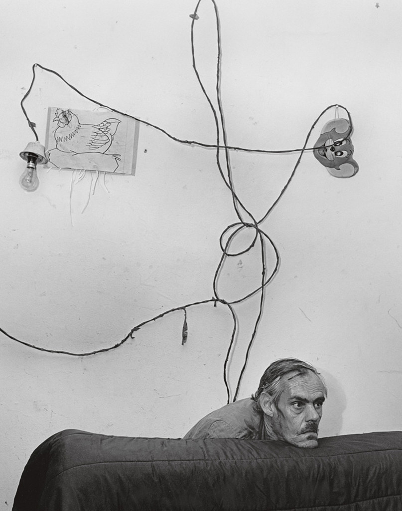 roger ballen artwork of a man infront of white wall