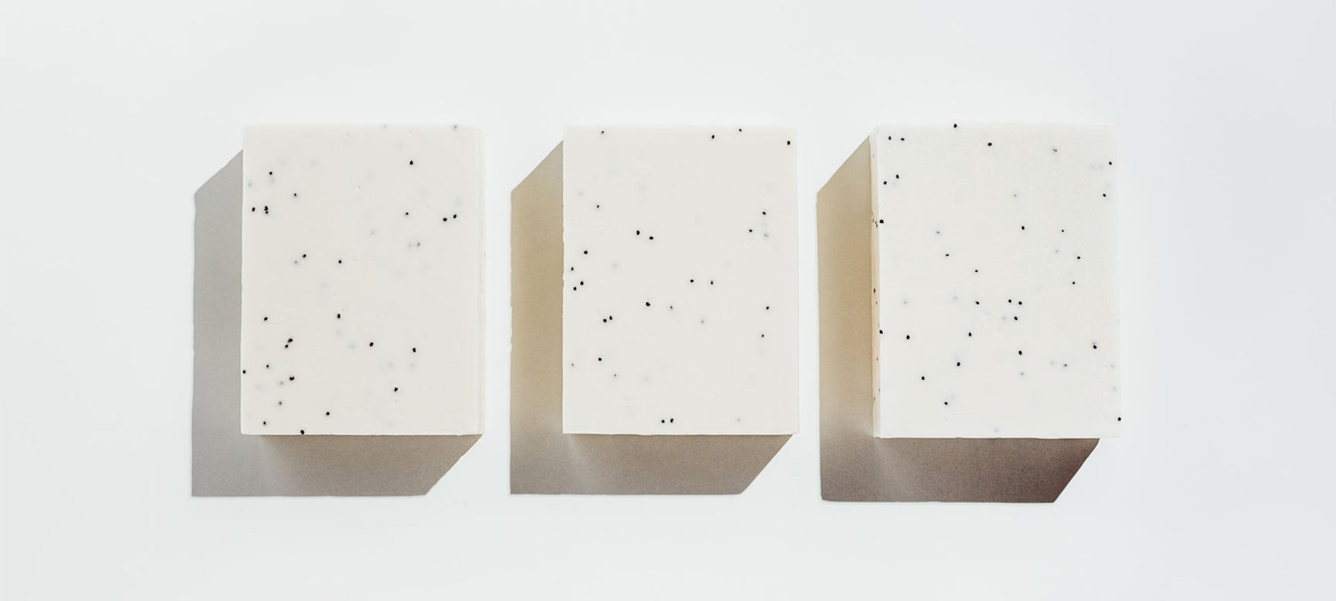 three blocks of white soap against a white background