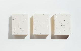 three blocks of white soap against a white background