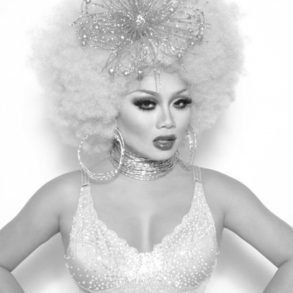 Drag queen Jujubee dressed up in glittering ensemble looks at the camera