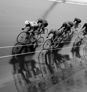 black and white image of cyclists keirin