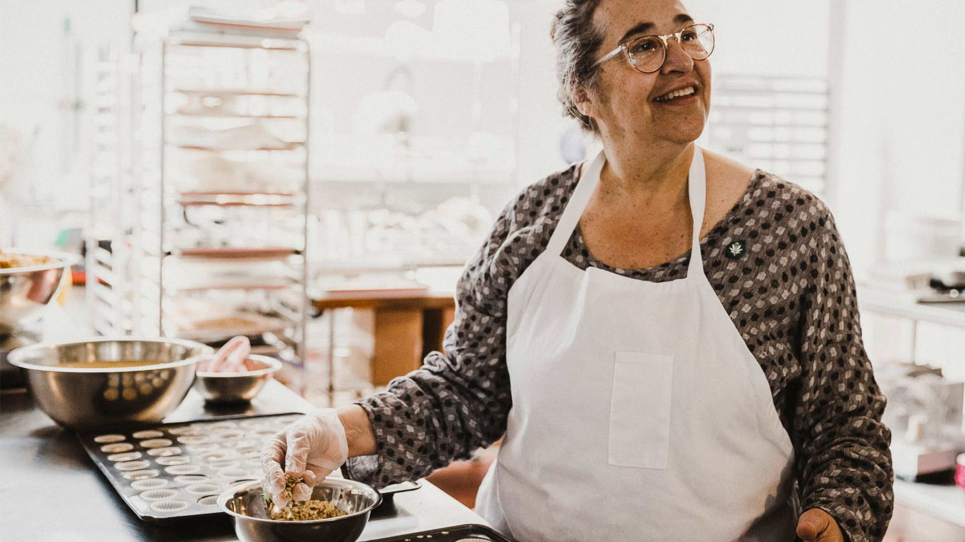 laurie wolf cooking edibles in a kitchen