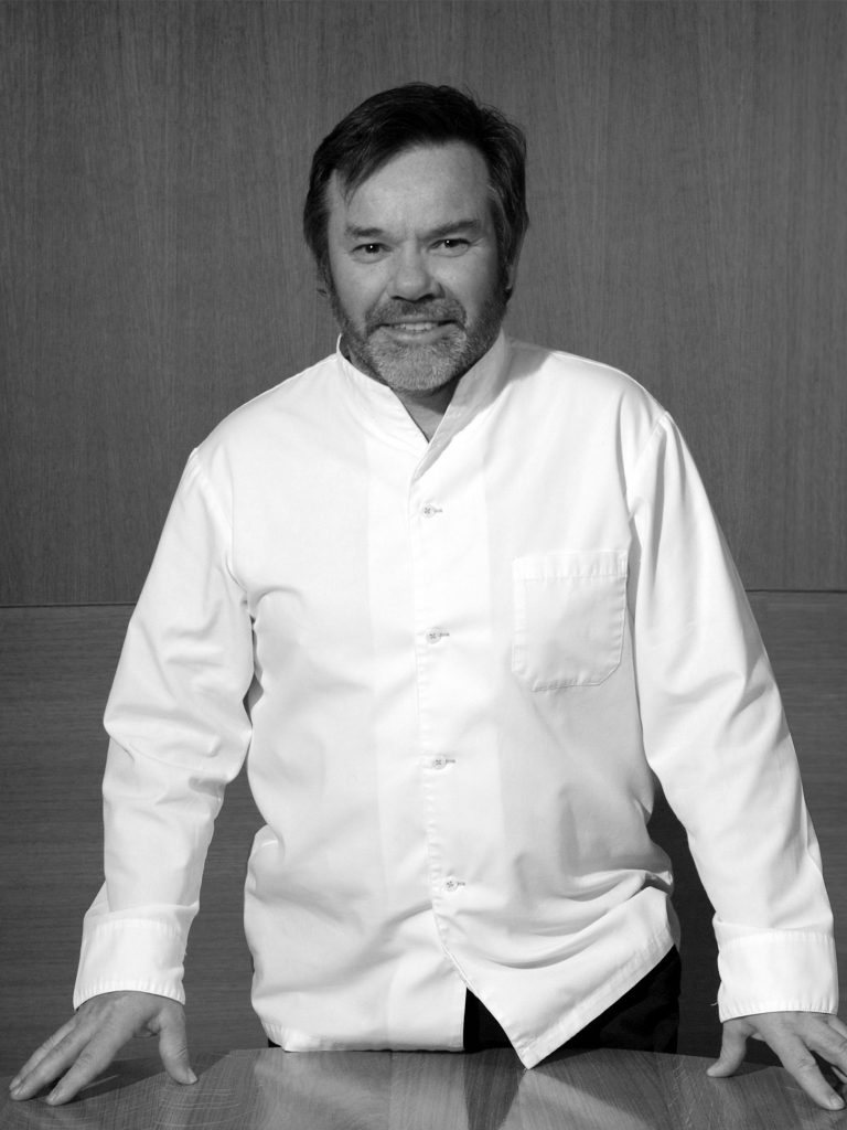 michel troisgros in chefs whites in a black and white image