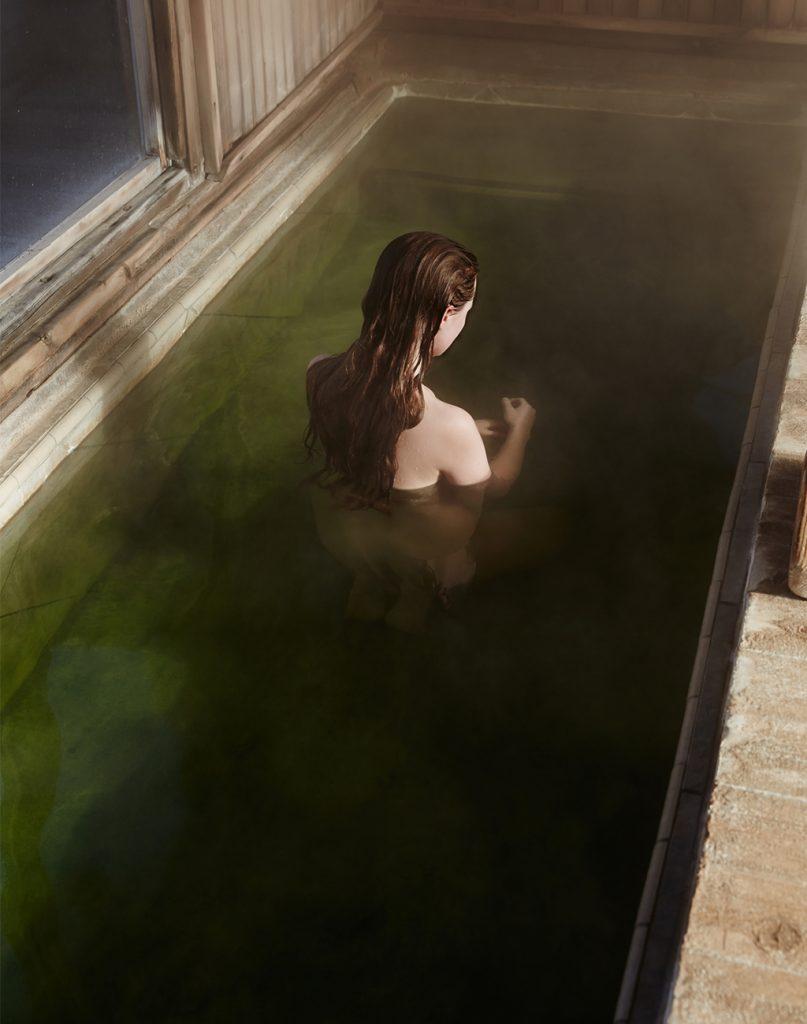 women bathes in green pool