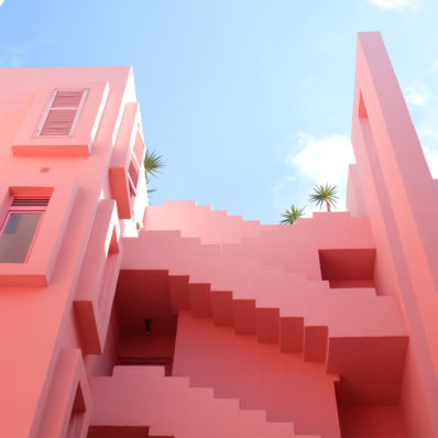Pink buildings against a clear blue sky