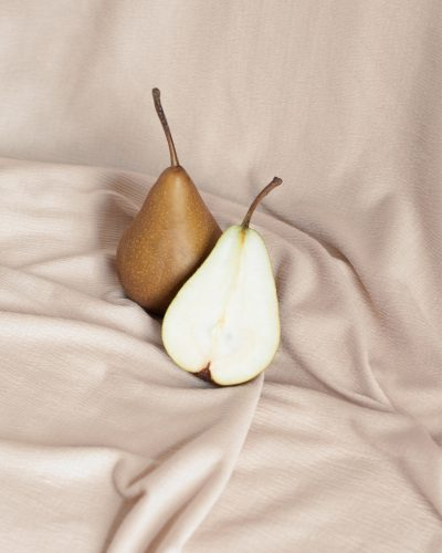 Pears nestled in a beige cloth