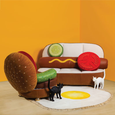 Hot dog and hamburger couches with egg print carpet