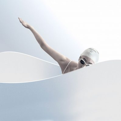 A female model poses as a swimmer in a white tub