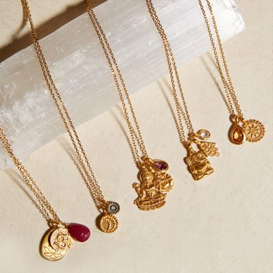 gold jewellery on beige cloth