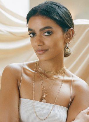 Stella Simona wearing white top and jewellery
