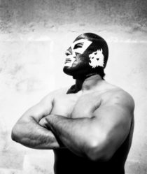 black and white image of a mexican wrestler
