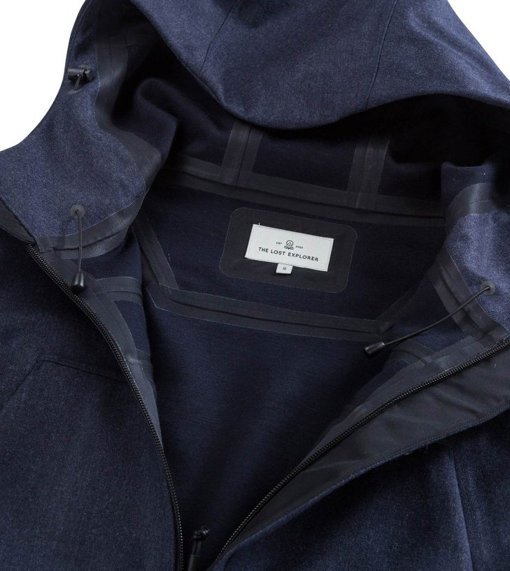 navy jacket open and showing the lost explorer label