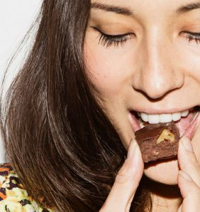 Jasmine Hemsley bites into a piece of chocolate