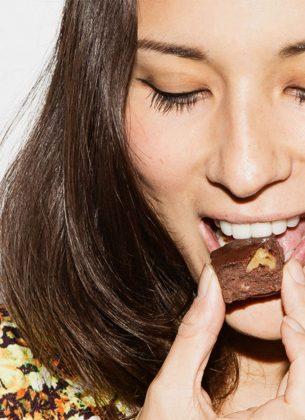 Jasmine Hemsley bites into a piece of chocolate