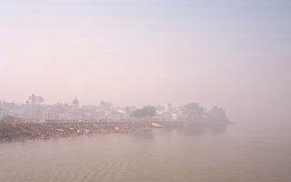 The river ganges at dusk tinted with a purple hue