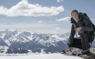 Adventurer Bear Grylls on top of a mountain