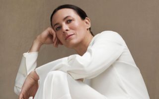 style influencer garance dore poses with handbag for interview