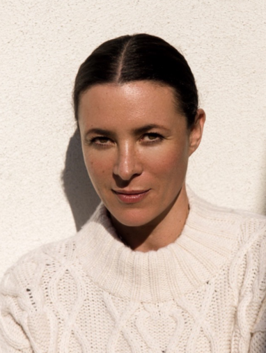 style influencer garance dore poses in white sweater