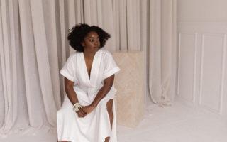 Interior designer Nike Onile poses in the studio